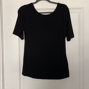 A New Day simple black tee with scoop back.